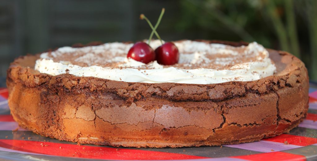 Flourless Chocolate Torte with Mascarpone Cream. Serve with cherry or raspberry sauce for a perfect gluten free dessert.