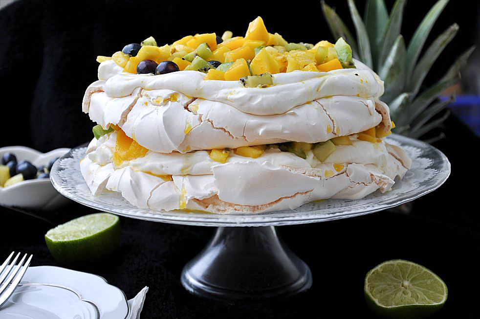 Mango & Pineapple Pavlova by Pretty Sweet Blog. Luscious layers of gluten free heaven.